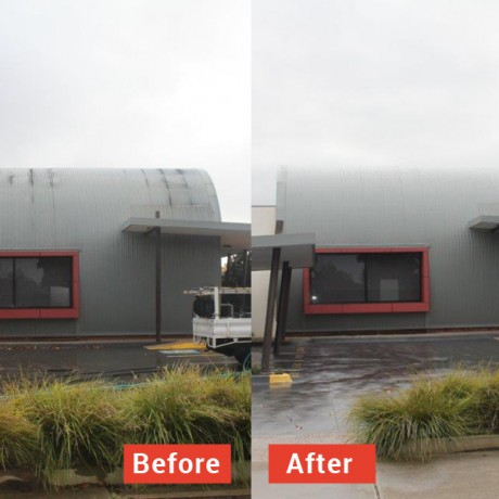 Grime removal from corrugated iron architectural building